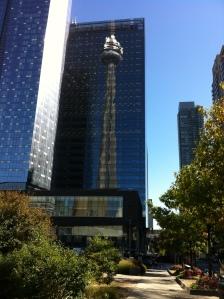 CN mirrored by glass skyscraper